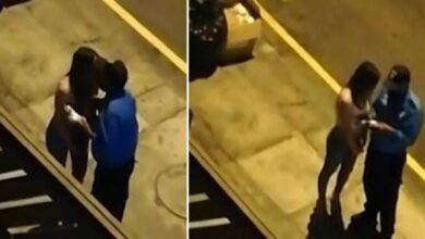 صورة بالفيديو.. امرأة تخترق حظر التجوال فيعاقبها الشرطي ب( قبلة